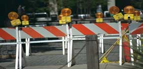 3 construction barricades with lights